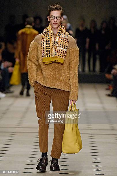 Model walks the runway at the Burberry Prorsum Autumn Winter 2015 fashion show during London Menswear Fashion Week on January 12, 2015 in London,...