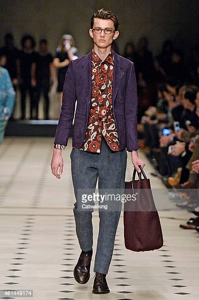 A model walks the runway at the Burberry Prorsum Autumn Winter 2015 fashion show during London Menswear Fashion Week on January 12 2015 in London...
