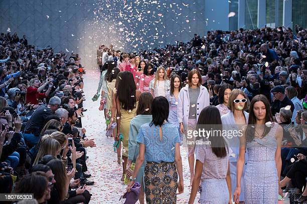 A model walks the runway at the Burberry Prorsum show at London Fashion Week SS14 at Kensington Gardens on September 16 2013 in London England