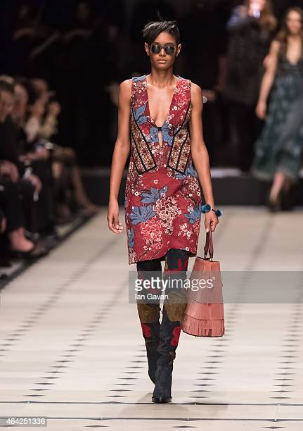 Model walks the runway at the Burberry Prorsum show during London Fashion Week Fall/Winter 2015/16 at perk's Field on February 23, 2015 in London,...