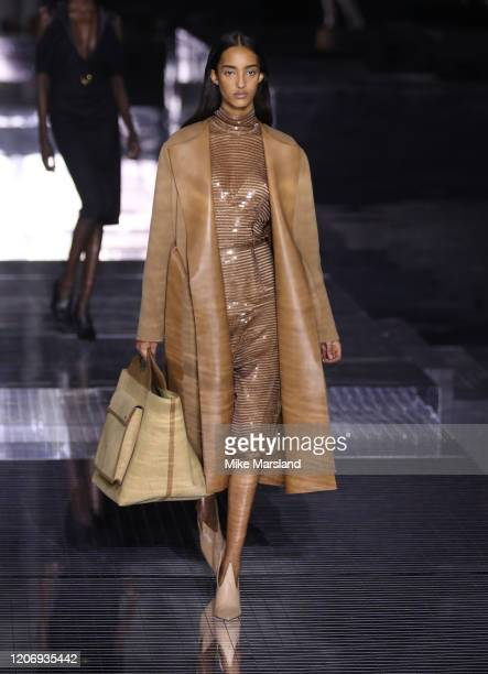 A model walks the runway at the Burberry show during London Fashion Week February 2020 on February 17 2020 in London England