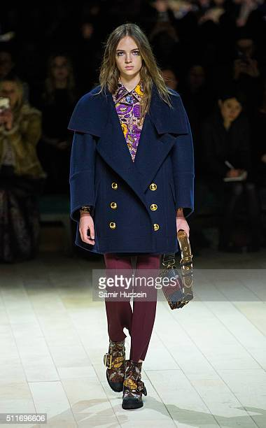 A model walks the runway at the Burberry show during London Fashion Week Autumn/Winter 2016/17 at Kensington Gardens on February 22 2016 in London...