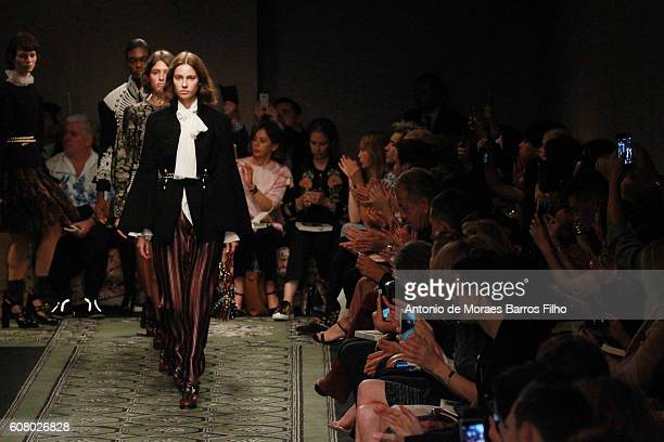 A model walks the runway at the Burberry show during London Fashion Week Spring/Summer collections 2016/2017 on September 19 2016 in London United...