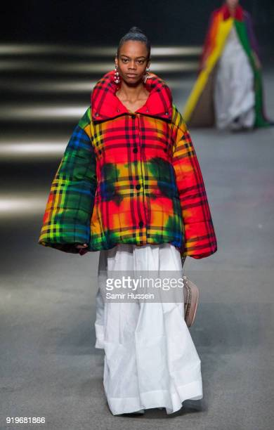 A model walks the runway at the Burberry show during London Fashion Week February 2018 at Dimco Buildings on February 17 2018 in London England