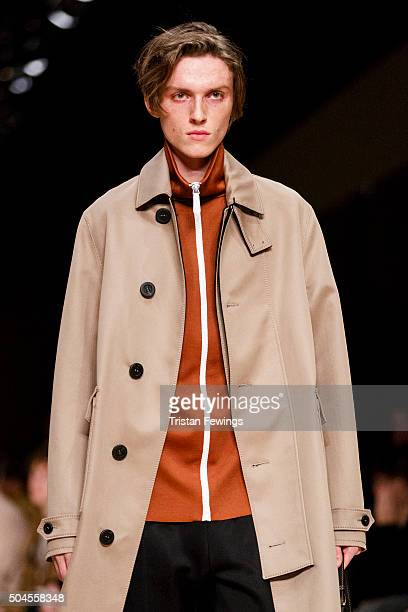 A model walks the runway at the Burberry show during The London Collections Men AW16 at Kensington Gardens on January 11 2016 in London England