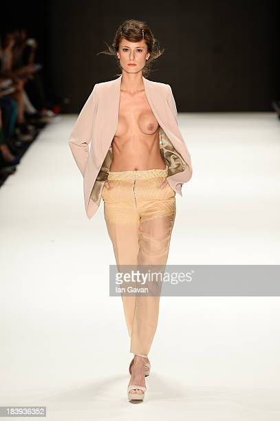 A model walks the runway at the Burce Bekrek show during MercedesBenz Fashion Week Istanbul s/s 2014 Presented By American Express on October 10 2013...