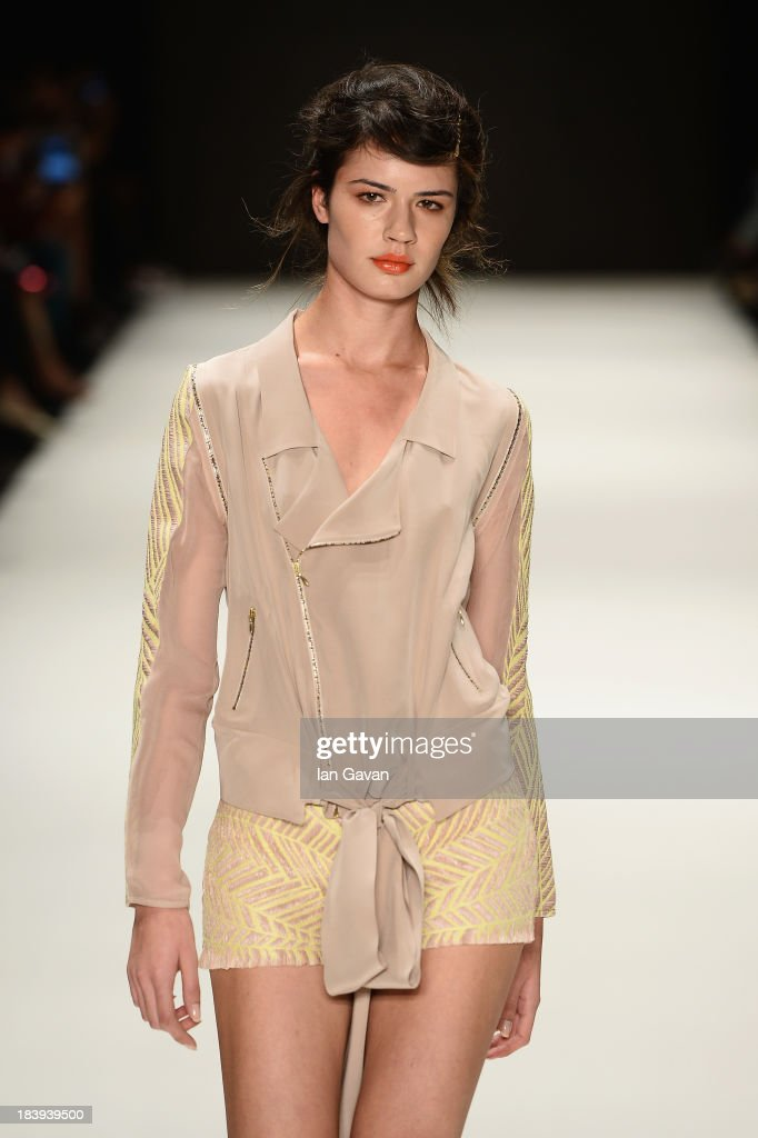 A model walks the runway at the Burce Bekrek show during Mercedes-Benz Fashion Week Istanbul s/s 2014 Presented By American Express on October 10, 2013 in Istanbul, Turkey.