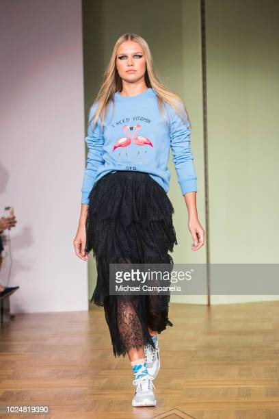Model walks the runway at the By Malina show during Stockholm Runway SS19 at Grand Hotel on August 28, 2018 in Stockholm, Sweden.