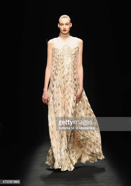 Model walks the runway at the Byblos show during Milan Fashion Week Womenswear Autumn/Winter 2014 on February 19, 2014 in Milan, Italy.
