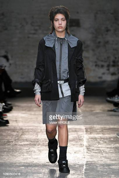 A model walks the runway at the C2H4 Fall/Winter 20192020 fashion show during London Fashion Week Men's January 2019 at the BFC Show Space on January...