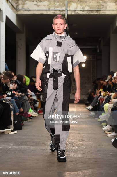 Model walks the runway at the C2H4 show during London Fashion Week Men's January 2019 at the BFC Show Space on January 06, 2019 in London, England.