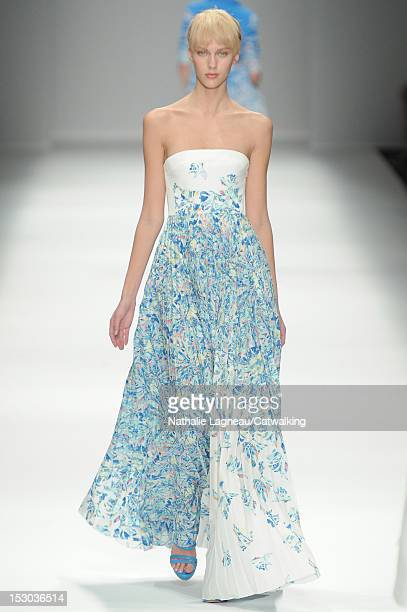 A model walks the runway at the Cacharel Spring Summer 2013 fashion show during Paris Fashion Week on September 29 2012 in Paris France