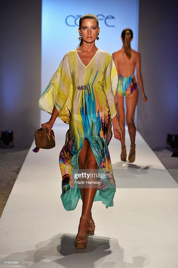 A model walks the runway at the Caffe Swimwear show during Mercedes-Benz Fashion Week Swim 2014 at Oasis at the Raleigh on July 21, 2013 in Miami, Florida.