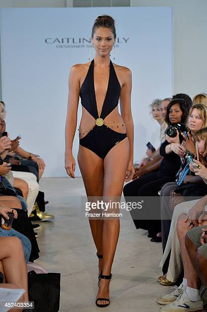 A model walks the runway at the Caitlin Kelly Designer Swimwear presentation during MercedesBenz Fashion Week Swim 2015 at the Penthouse at The...