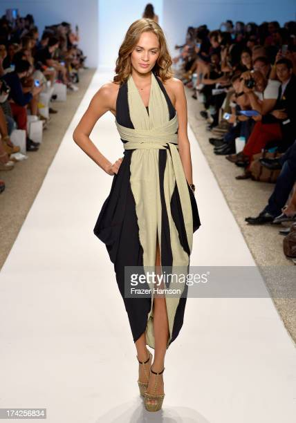 A model walks the runway at the Caitlin Kelly Swimwear show during MercedesBenz Fashion Week Swim 2014 at the Raleigh on July 22 2013 in Miami Beach...