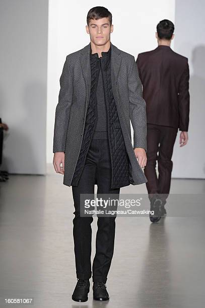 A model walks the runway at the Calvin Klein Autumn Winter 2013 fashion show during Milan Menswear Fashion Week on January 13 2013 in Milan Italy