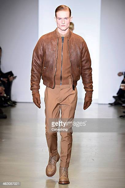A model walks the runway at the Calvin Klein Collection Autumn Winter 2014 fashion show during Milan Menswear Fashion Week on January 12 2014 in...