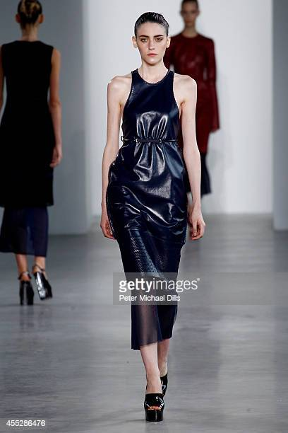A model walks the runway at the Calvin Klein Collection fashion show during MercedesBenz Fashion Week Spring 2015 at Spring Studios on September 11...