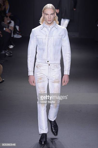 A model walks the runway at the Calvin Klein Collection show during Milan Men's Fashion Week Fall/Winter 2016/17 on January 17 2016 in Milan Italy