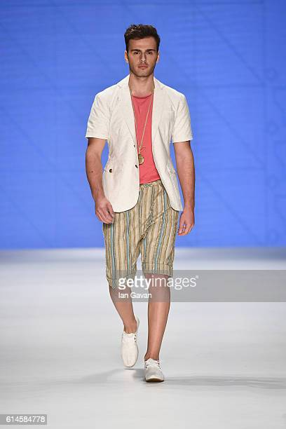 A model walks the runway at the Can Yunus Cetinkaya show during MercedesBenz Fashion Week Istanbul at Zorlu Center on October 14 2016 in Istanbul...
