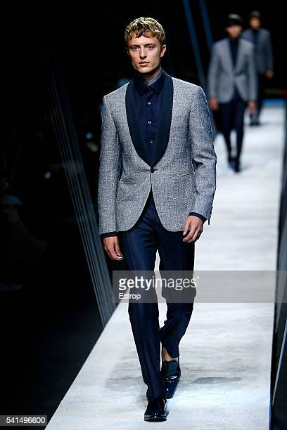 A model walks the runway at the Canali designed by Andrea Pompilio show during Milan Men's Fashion Week SS17 on June 18 2016 in Milan Italy