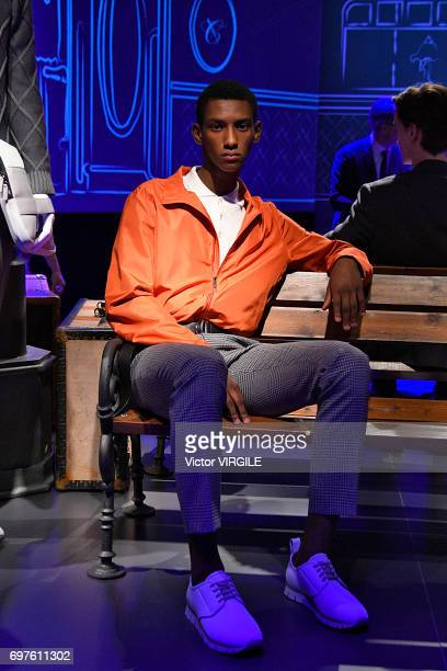 A model walks the runway at the Canali fashion show during Milan Men's Fashion Week Spring/Summer 2018 on June 17 2017 in Milan Italy