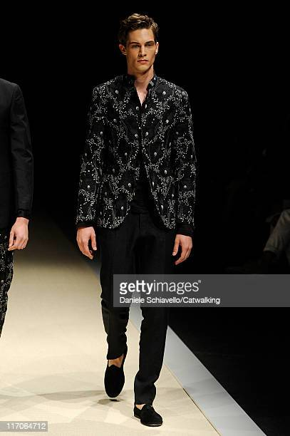 A model walks the runway at the Canali menswear fashion show during Milan Fashion Menswear Week on June 20 2011 in Milan Italy
