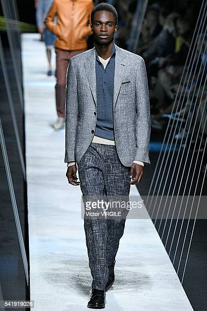 A model walks the runway at the Canali show during Milan Men's Fashion Week Spring/Summer 2017 on June 18 2016 in Milan Italy
