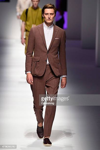 A model walks the runway at the Canali Spring Summer 2016 fashion show during Milan Menswear Fashion Week on June 22 2015 in Milan Italy