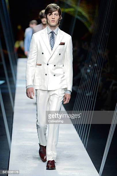 A model walks the runway at the Canali Spring Summer 2017 fashion show during Milan Menswear Fashion Week on June 18 2016 in Milan Italy