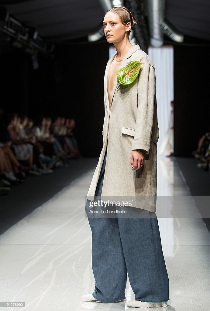 A model walks the runway at the Carin Wester show at Fashion Week in Stockholm SS 15 on August 27, 2014 in Stockholm, Sweden.