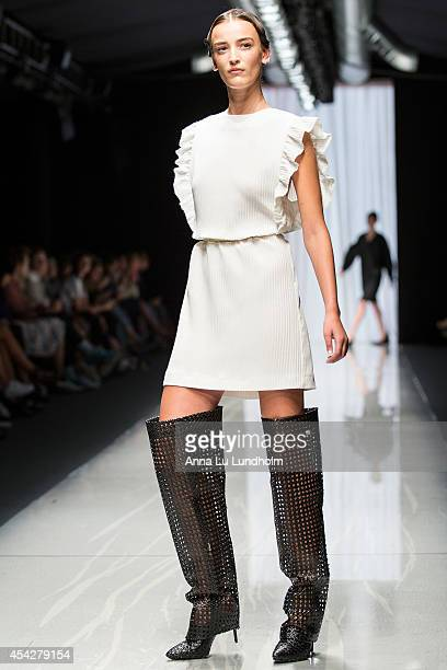 A model walks the runway at the Carin Wester show at Fashion Week in Stockholm SS 15 on August 27 2014 in Stockholm Sweden