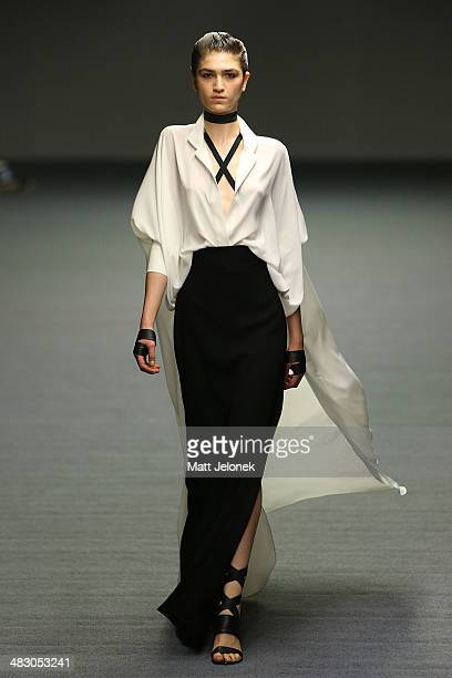 Model walks the runway at the Carla Zampatti show during Mercedes-Benz Fashion Week Australia 2014 at Carriageworks on April 6, 2014 in Sydney,...
