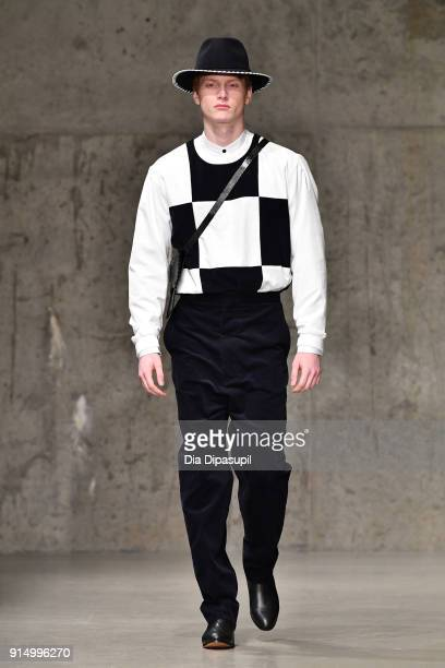 A model walks the runway at the Carlos Campos fashion show during New York Fashion Week Mens' at Skylight Modern on February 6 2018 in New York City