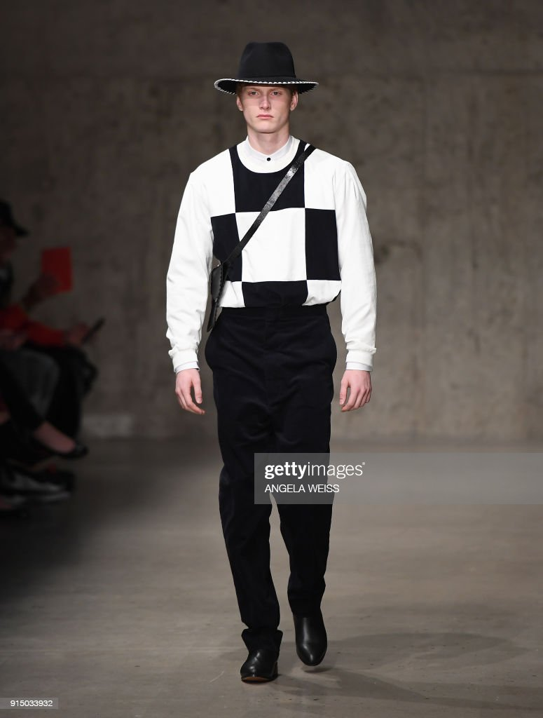 A model walks the runway at the Carlos Campos fashion show during New York Fashion Week Mens' at Skylight Modern on February 6, 2018 in New York City. /