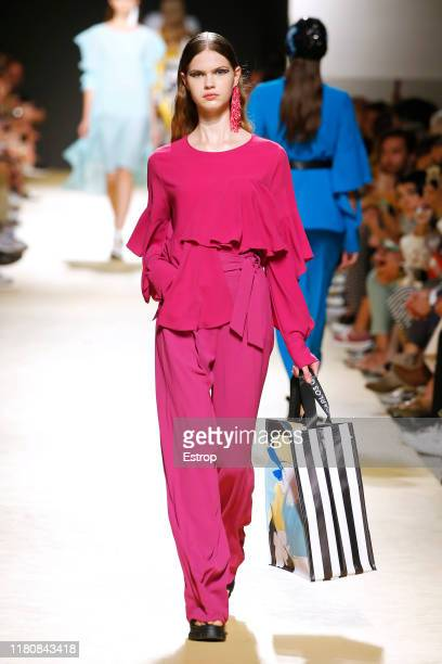 A model walks the runway at the Carlos Gil fashion show during Lisboa Fashion Week 'ModaLisboa' S/S 2020 on October 13 2019 in Lisboa Portugal