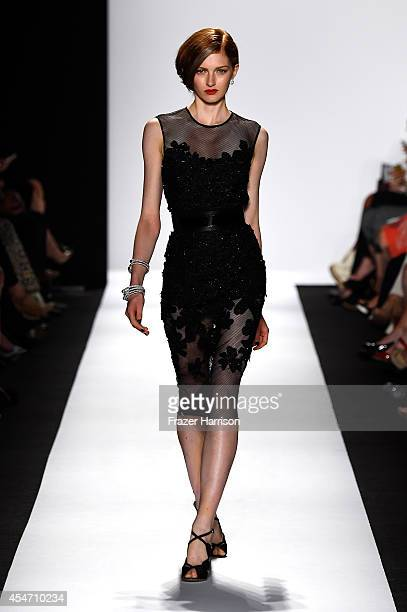 A model walks the runway at the Carmen Marc Valvo 25th Anniversary fashion show during MercedesBenz Fashion Week Spring 2015 at The Theatre at...