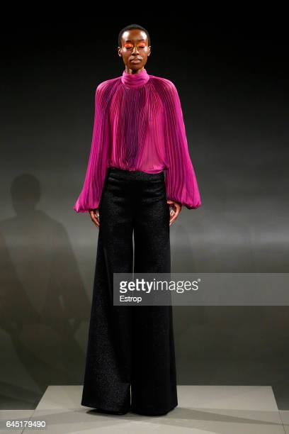 A model walks the runway at the Carmen Marc Valvo show during the New York Fashion Week February 2017 collections on February 14 2017 in New York City