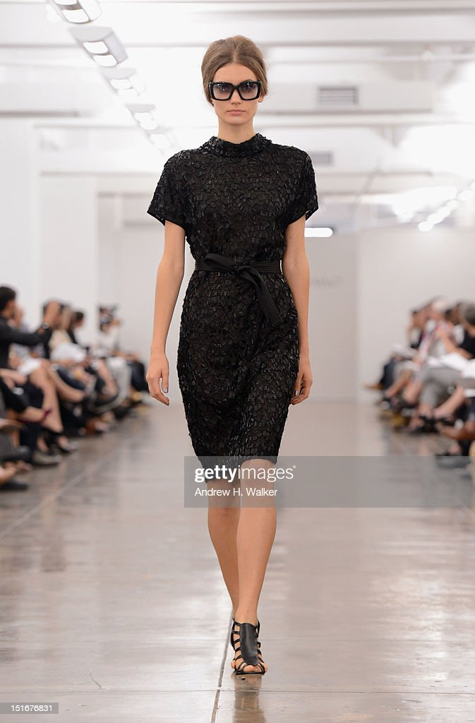 A model walks the runway at the Carmen Marc Valvo Spring 2013 fashion show during Mercedes-Benz Fashion Week at 575 7th Avenue on September 9, 2012 in New York City.