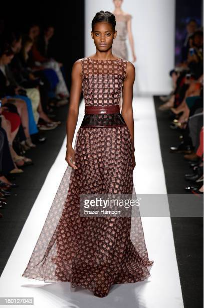 Model walks the runway at the Carolina Herrera fashion show during Mercedes-Benz Fashion Week Spring 2014 at The Theatre at Lincoln Center on...