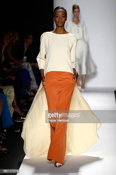 A model walks the runway at the Carolina Herrera fashion show during MercedesBenz Fashion Week Spring 2014 at The Theatre at Lincoln Center on...
