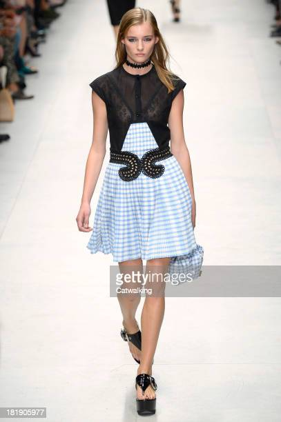 Model walks the runway at the Carven Spring Summer 2014 fashion show during Paris Fashion Week on September 26, 2013 in Paris, France.