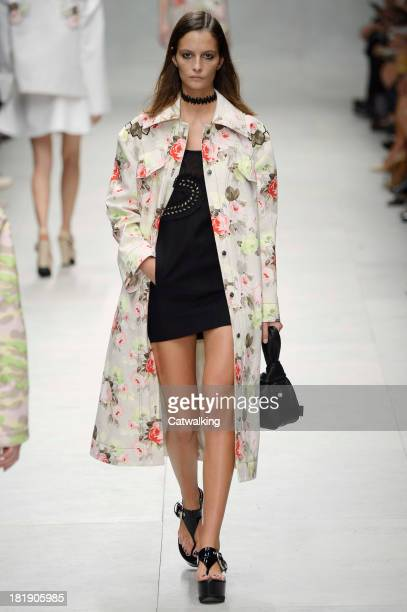 A model walks the runway at the Carven Spring Summer 2014 fashion show during Paris Fashion Week on September 26 2013 in Paris France