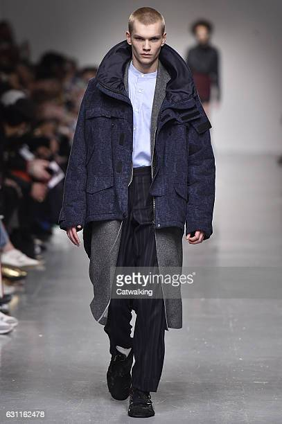 A model walks the runway at the CaselyHayford Autumn Winter 2017 fashion show during London Menswear Fashion Week on January 7 2017 in London United...