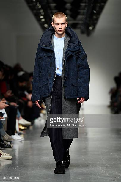 A model walks the runway at the CaselyHayford show during London Fashion Week Men's January 2017 collections at BFC Show Space on January 7 2017 in...