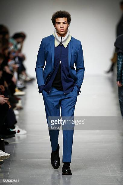 Model walks the runway at the Casely-Hayford show during London Fashion Week Men's January 2017 collections at BFC Show Space on January 7, 2017 in...