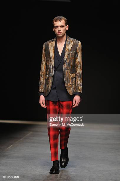 A model walks the runway at the CaselyHayford show during The London Collections Men Autumn/Winter 2014 on January 7 2014 in London England