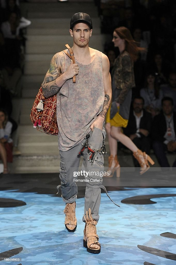 A model walks the runway at the Cavalera show at Sao Paulo Fashion Week Winter 2014 on October 30, 2013 in Sao Paulo, Brazil.