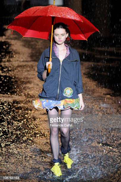 A model walks the runway at the Cavalera show during the sixth day of Sao Paulo Fashion Week Fall 2011 at Ibirapuera's Bienal Pavilion on February 2...