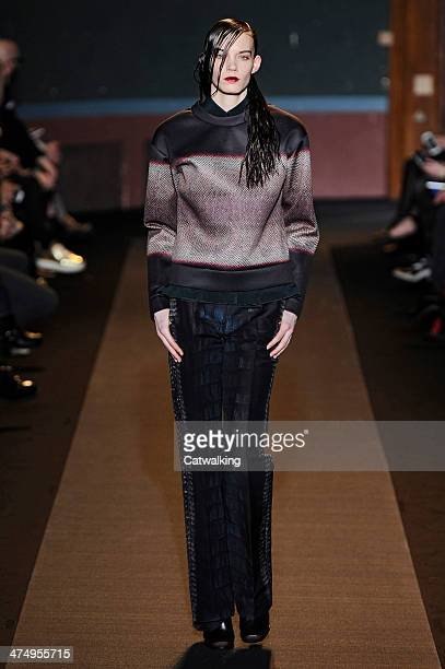 Model walks the runway at the Cedric Charlier Autumn Winter 2014 fashion show during Paris Fashion Week on February 25, 2014 in Paris, France.